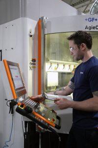 Krones' Ryan Anderson at mold-making center on HEIDENHAIN TNC.