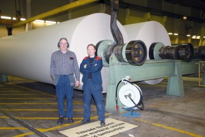 Roland Lindström and Ulf Ahlstrand by the 8.4 meter paper rolls that are then cut down into the required widths and supplied to printers and newspaper publishers.
