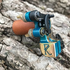 Handheld teal tattoo machine developed by Dan Kubin