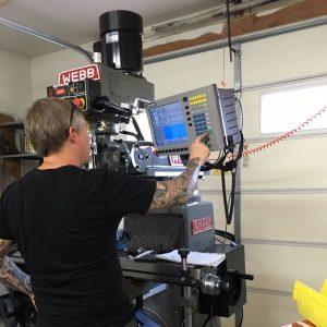 Dan Kubin working in garage with Webb milling machine